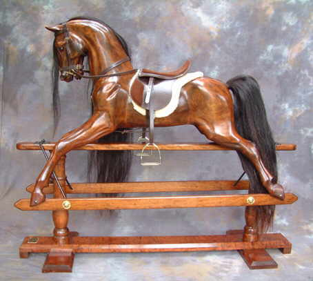 cherry rocking horse on safety stand